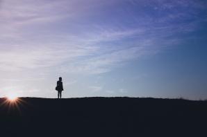 woman sillhouette hill